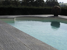 Terrasse piscine carrelee for Prix piscine carrelee